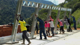 Raising a building frame in rural Colombia